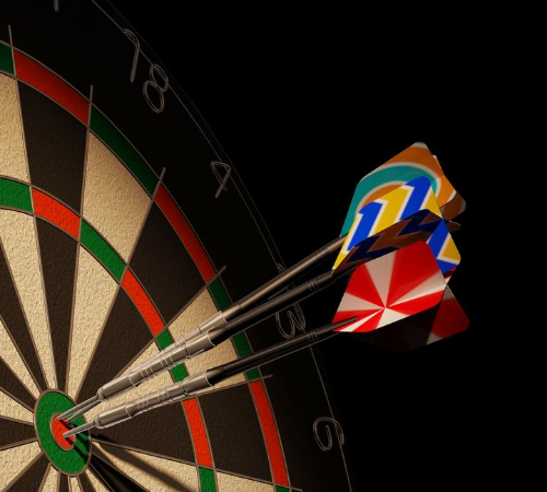 darts board with three darts on bullseye